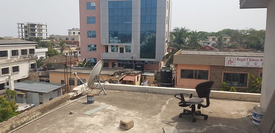 The Ritzz Exclusive Guest House: ...Nice views on the roof!  Even a chair for the staff is there.