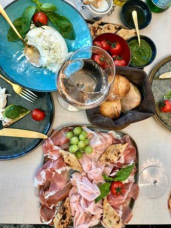 Burrata Gigante and a plate of truffle Mortadella and Parma ham