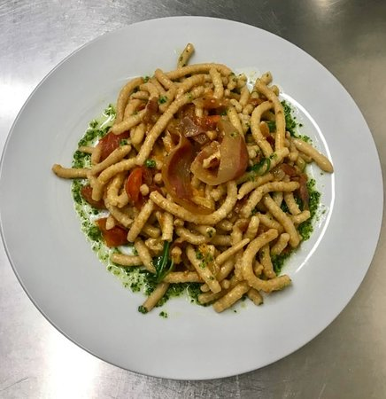 IL NOVE: Homemade Passatelli with pesto, cherry tomatoes and bacon
