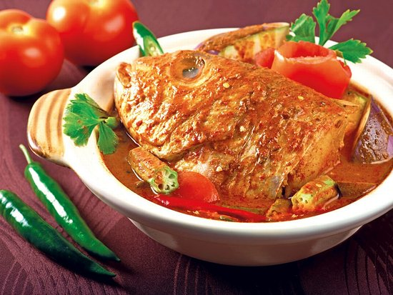 FISH HEAD CURRY  Fish head semi stewed in a thick curry with assorted vegetable