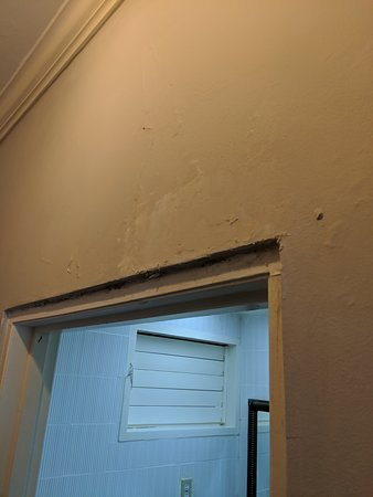 Paint bubbling/peeling on the walls in the rooms.