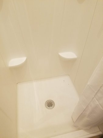 tiny, filthy shower stall in women's dorm