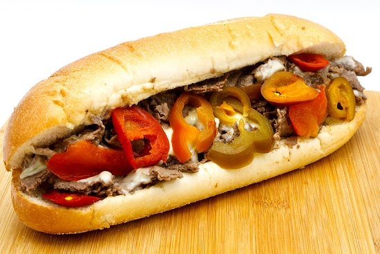 """Bradley's Cheesesteaks & Hoagies: Ribeye beef cooked on our flat top grill with hot cherry peppers, sweet bell peppers, your choice of cheese. Served on an 8"""" Italian roll, delivered fresh daily straight 'outta Philadelphia."""