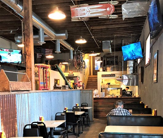 Tribune Smokehouse: View - one side of pub- kitchen at end of picture. Lots of memorabilia on the walls to look at.