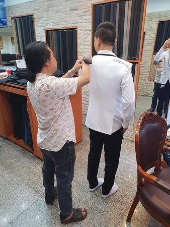 Groom getting fitted