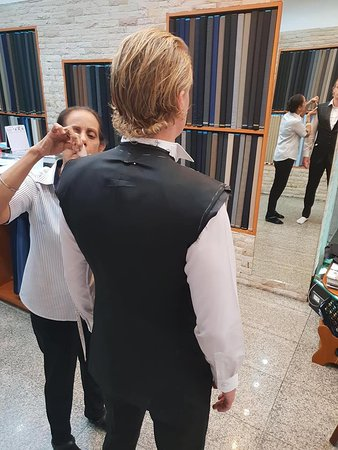 Groomsman getting fitted