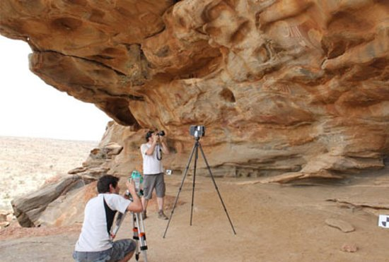 Somaliland, Somalia: visitors taking pictures laas geel cave painting
