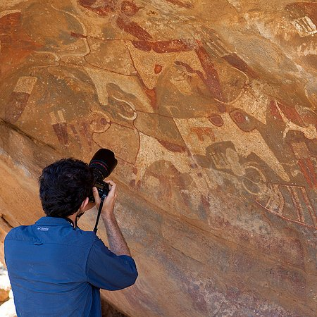 Somaliland, Somalia: visitor taking picture laas geel caves