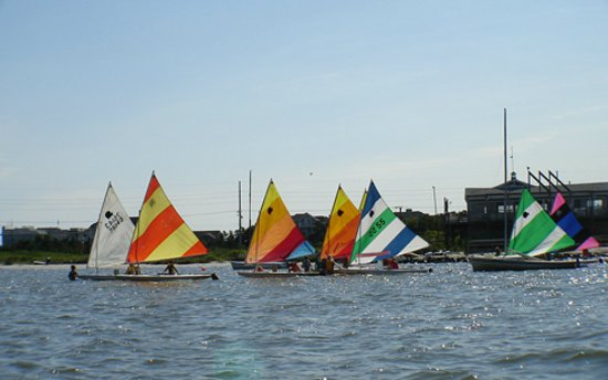 Dewey Beach, DE: The sailing school fleet heads out onto the bay. Private lessons are also available.