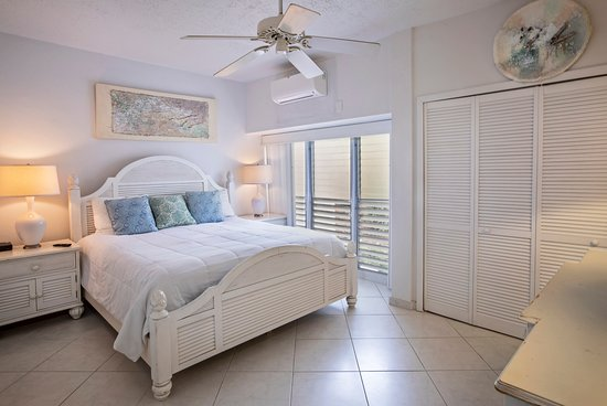 Hillside 2 bedroom condominium master bedroom with king bed