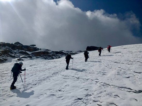 Ascending the glacier part. It's not steep nor very long to the top but the altitude makes it harder than it looks!