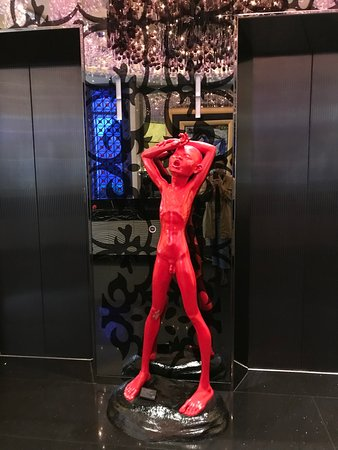 Sculpture by elevator in hotel lobby.