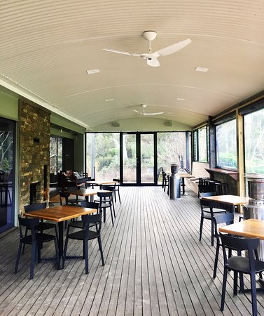 Our deck is partially enclosed and features a double sided fire place to keep you warm during the cooler months.