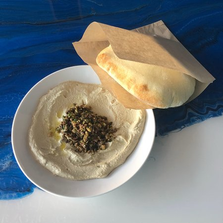 Meze Morada: Our special hummus of the week: Olive + toasted walnut! And served with our from scratch fresh puffy pita!