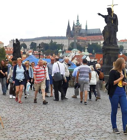 It seemed that all tourists had converged on the bridge.I thought Charles Bridge was one of the most beautiful among the scores of bridges I had seen all over during my travels.I could look out to the amazing beauty of Prague's medieval palaces and churches.
