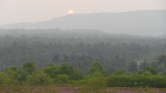 Sunset behind the Ezhimala seen from Madayipara