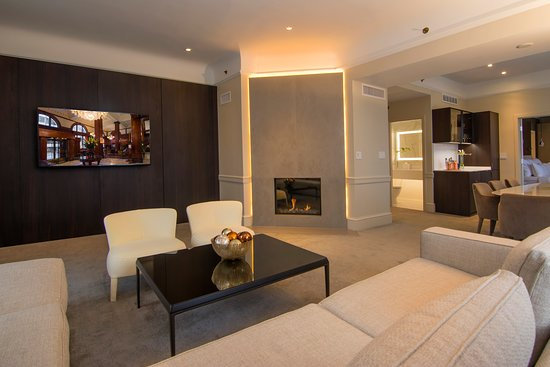 A floor to ceiling gas fireplace in the Presidential Suite creates an inviting ambiance.