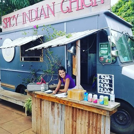 The Spicy Indian Chick waiting on her customers