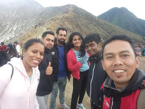 Bromo Tengger Semeru National Park, Indonesia: our happy customers stay on rim of Bromo Crater to take panoramic selfie photos with our tour guide