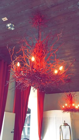 Cool driftwood looking red chandelier that matched the drapes.