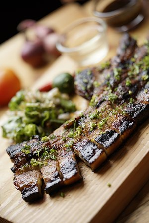 Asian Spiced Pork Belly- made from our own marinade, a recipe concocted to make you come back for more.