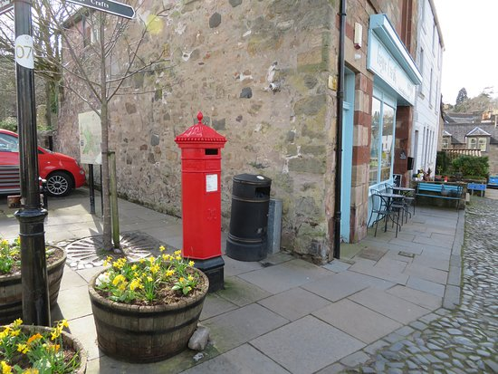 on the corner beside the post box