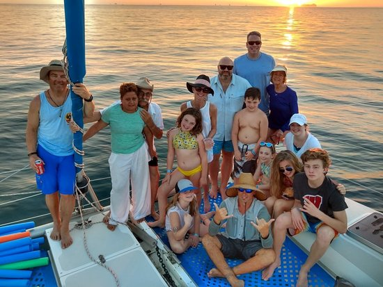 ConchalFun: Andrei with awesome group on private catamaran sunset cruise