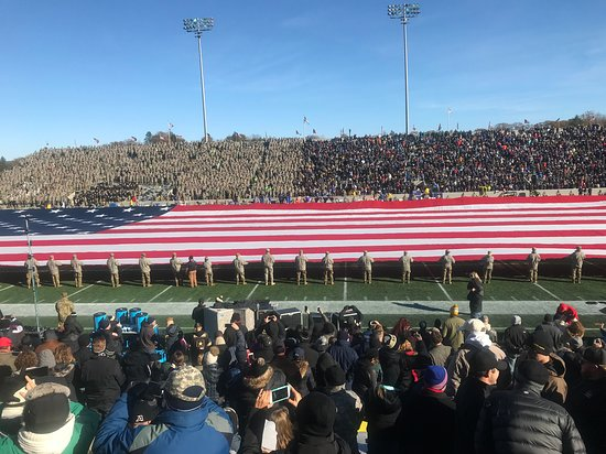 Corps of Cadets and fans stand for the National Anthem at Michie Stadium