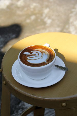 Nowadays a restaurant without coffee, is like a human body without a soul. Over reaching there, but you have got to say coffee nowadays is just like water. It's a need. We provide. Here we have our Cappucino.