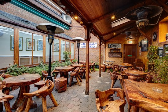 Uppercross House Hotel: Heated Beer Garden   With many hidden alcoves, you can enjoy a quiet point or join in with the live entertainment. Mother Reilly's is the perfect place to watch the match on one of our many TV screens inside the bar our outside in the heated beer garden. You can play darts or pool too if you're game!