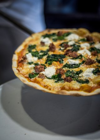 Pizzeria Casavostra: Every month a new pizza! In January we had spicy sausage, spinach and ricotta cheese