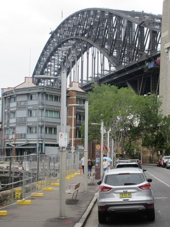 Sydney Bike Tours: Millers Point and the Finger Wharves overshadowed by the Sydney Harbour Bridge.
