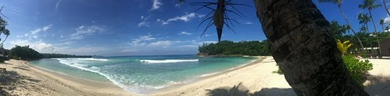 Grand Anse, Seychellen: Panorama of the beach at Avani Barbarons Resort & Spa, Mahe,  Seychelles
