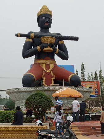 Large statue of a man holding a stick