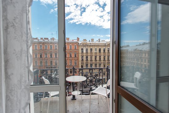 Comfort room for 2-4 guests with balcony and view on Nevsky prospekt.