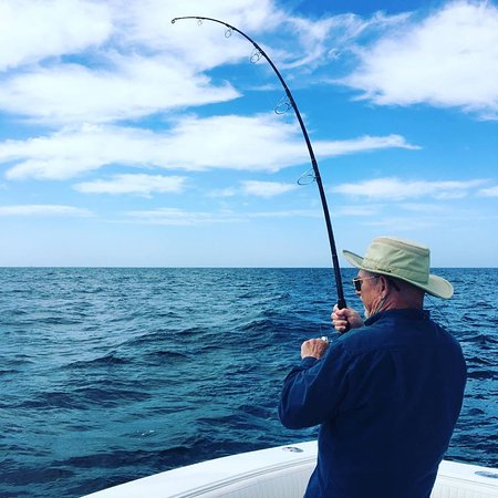 Reeling in a good one on an offshore fishing trip!