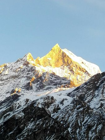 Chame, Nepal: Someone might be pondering on this photo saying where is this.If so let me reveal this.This is Fishtail mountain From Nepal.if you want to see this  mountain and have similar photos try Mardi Himal trek from Eco Holidays Nepal.