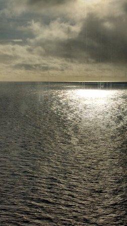 Carnival Legend: Sun reflection Coral Sea