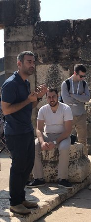 Boker Tours: Assaf explaining to history of the first temple at Capernaum on the Sea of Galilee.
