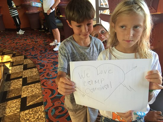 Carnival Elation: As always, thanks to Camp Carnival.  Here is our 7 time cruiser Anthony and is 1st time cruiser cousin Carly getting 2nd place in the scavenger hunt.  They loved Camp Carnival.