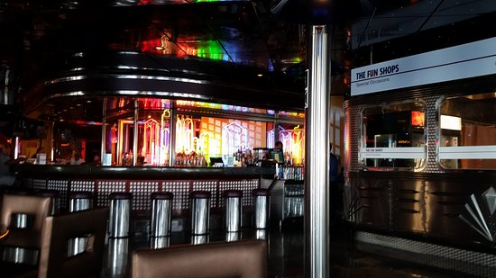 Carnival Ecstasy: Bar on promenade deck, close to live music, casino, smoking, trivia, comedy lounge, etc.