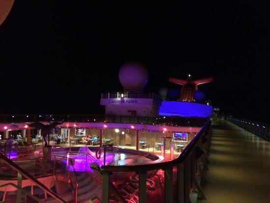 Carnival Spirit: Looking down over the pools in the evening.