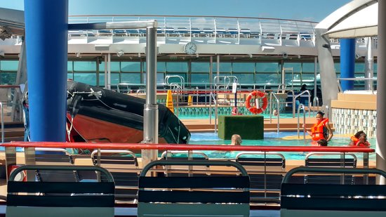 Explorer of the Seas: Crew members practicing flipping over a crew life raft.