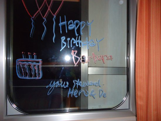 Carnival Conquest: Steward Heru wrote on our window for my 60th birthday.  What a sweetie!!  R