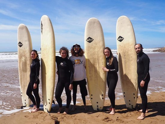 Our surf instructor with our good clients :)