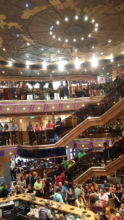 Carnival Triumph Atrium. The crowd of passengers waiting for the caroling a