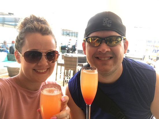 Norwegian Dawn: Breakfast Mimosa's at the pool bar (with some added grenadine for my sw