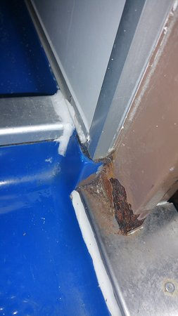 Carnival Ecstasy: Rusted area on door...glad I didn