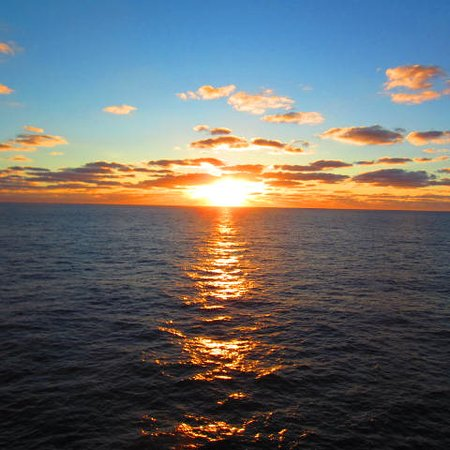 Norwegian Dawn: From our balcony on the way down. sunrise.