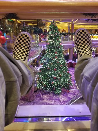 Grandeur of the Seas: A sideways pic of my feet over looking the Christmas Tree in the centrum